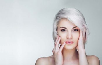 Woman with short platinum blond hair.